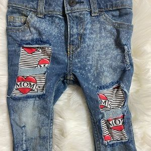 "Distressed ""mom"" jeans"